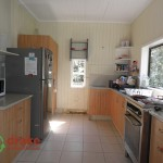 Modernised kitchen with cupboards stove and fridge