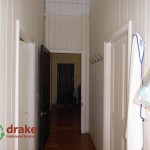 1896 original colonial hallway with hanging hooks