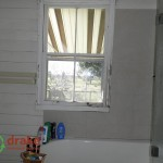 Old original colonial bathroom with bath and timber window